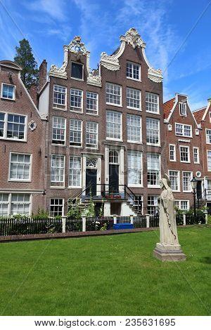 Amsterdam City Architecture - Begijnhof Residential Buildings. Netherlands Rowhouse.