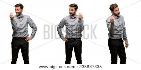Middle age man, with beard and bow tie angry gesturing typical italian gesture with hand, looking to camera
