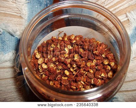 Szechuan Seasoning Szechuan Peppercorns For Seasoning In A Glass Jar