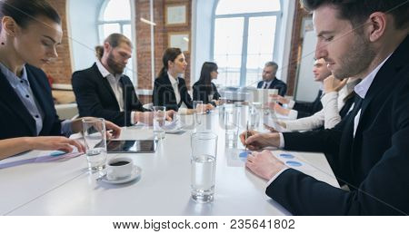 Business people at meeting in office discuss financial charts