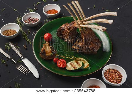 Rack Of Lamb With Grilled Vegetables With Cutlery And Spices. Restaurant Serving Of Bbq Meat With Mu