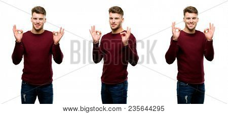 Handsome blond man doing ok sign gesture with both hands expressing meditation and relaxation isolated over white background
