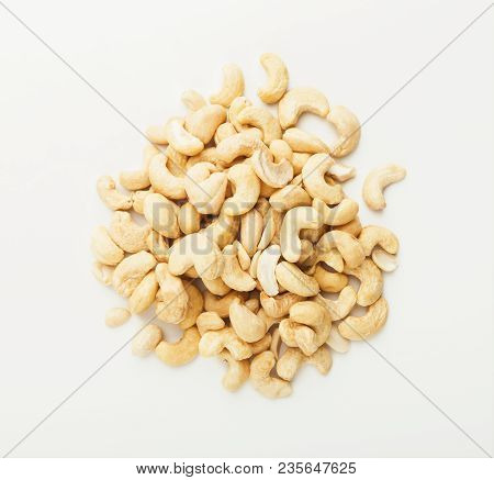 Pile Of Raw Cashew Nuts Isolated On White Background, Cutout, Top View