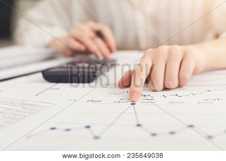 Closeup Of Woman Hands Working With Financial Documents And Counting On Calculator. Financial Backgr