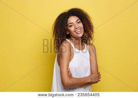 Headshot Portrait Of Beautiful Attractive African American Woman Posting Crossed Arms With Happy Smi