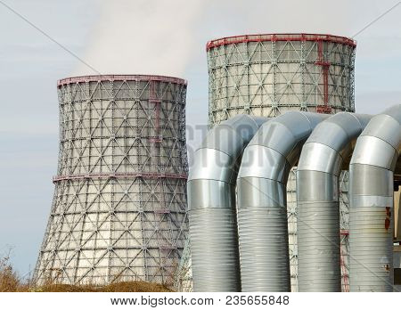 Large Cooling Pipes At The Thermal Power Plant.inside Them Steam Is Cooled And Condensed Water.