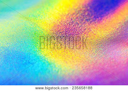 Rainbow Real Holographic Foil Texture Background. Holographic Background. Vibrant Neon Texture. Tren