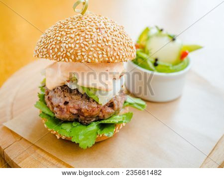 Burger With A Large Chop And White Sauce