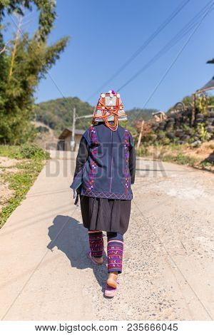 Chiang Rai, Thailand - February 8, 2017: Unidentified Akha woman with traditional clothes and decorated hat in Akha hilltribe village in Northern Thailand