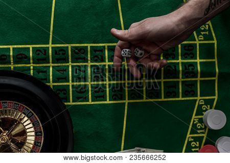 Top View Of Man Gambling On Roulette At Casino, Gambling Addiction Concept