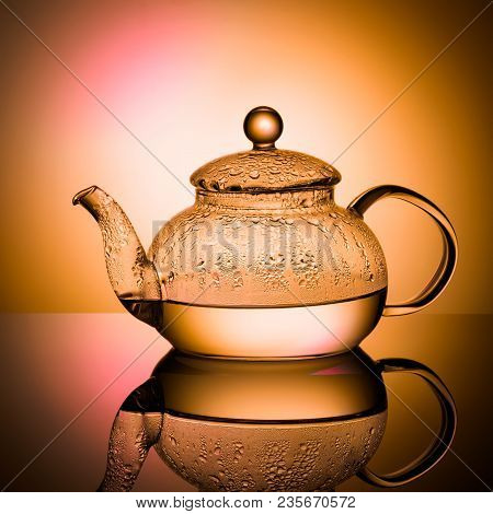 Glass Teapot With Boiling Water And Drops Of Condensation On Glass Advertising Shot On Light Multy C