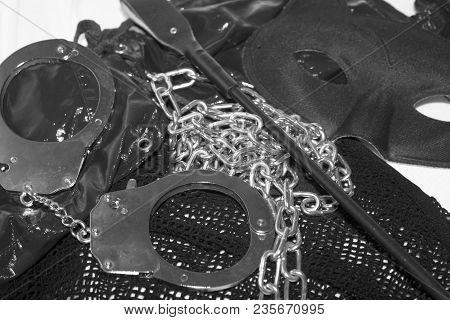 Black Bdsm Erotic Toys, Whip, Eye Mask, Chain, Hand Cuffs, Pleasure Sex Concept Photo. Fetish Erotic