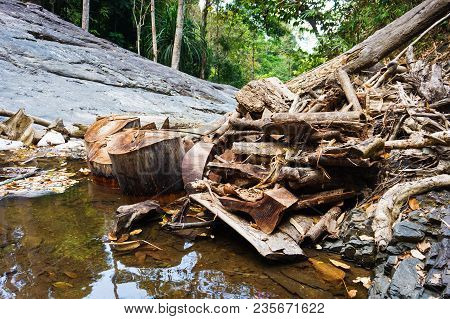 Natural Dam From Fallen Trees On Mountain River In Jungle