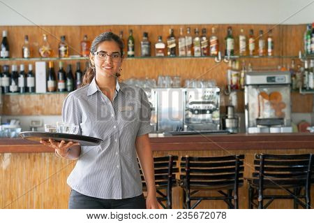 The Waitress Is Carrying Cups For Tea To The Client Of The Hotel Restaurant. A Nice Waitress Holds A