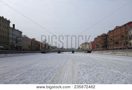 Winter Day And A Walk Along The Ice Of The Fontanka River In St. Petersburg