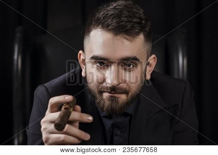 Portrait Of A Man In A Suit, Resting And Smoking An Expensive Cigar. Expensive Way Of Life