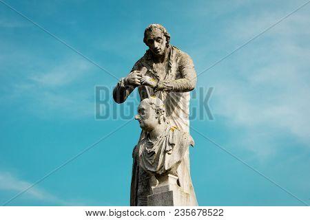 The Statue Of Antonio Canova. Sculpture On Blue Sky Background. The Statue Located In Prato Della Va