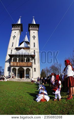 BREB, ROMANIA - 09 APRIL, 2018 - Locals dressed in traditional clothes, celebrating the Easter Holidays in Breb Village, Maramures, Romania