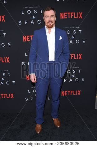 LOS ANGELES - APR 09:  Toby Stephens arrives to the premiere of Netflix's