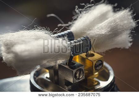 Vape Device Or Dripping Rda Without Top Cap, Coils And Cotton Fore Vapour Clouds. Electronic E - Cig