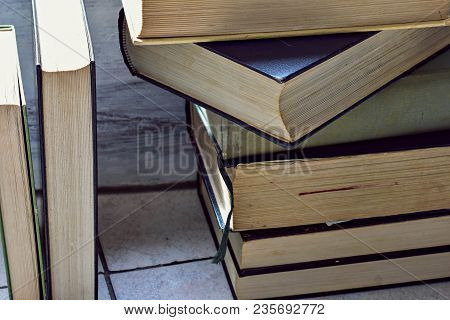 A Stack Of Old Dusty Book(s) Stacked On Top Of Each Other