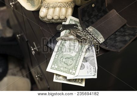 Key Holder And Cash Laid On The Desk Top, Indoor Closeup