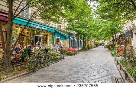 Paris, France - May 8, 2016. A Quiet Street With Restaurants In The Bohemian Marais District Of Pari