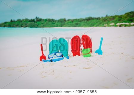 Flip Flops, Toys And Diving Mask At Tropical Beach