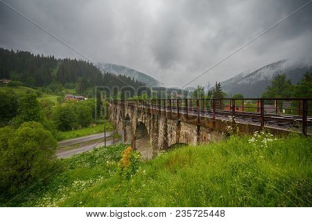 Old Austrian Stone Railway Bridge Viaduct In Vorohta.   Ukraine