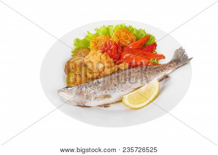 Fish Trout Whole With A Head Baked Fried Over An Open Fire With Side Dish Vegetables A Slice Of Lemo