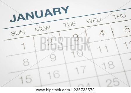 Closeup Calendar Page With Days And Dates In January Month. Selective Focus Shown Dot Prints, Blurre