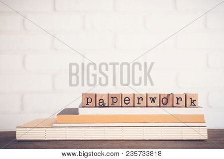 The Word Paperwork, Alphabet On Wooden Cubes On Top Of Books. Background Copy Space, Vintage And Min