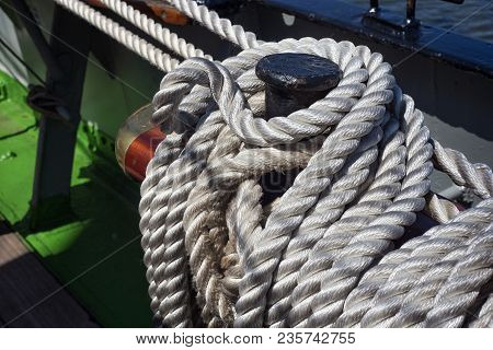 Steel Belaying Pins With Ropes On A Sailing Ship.