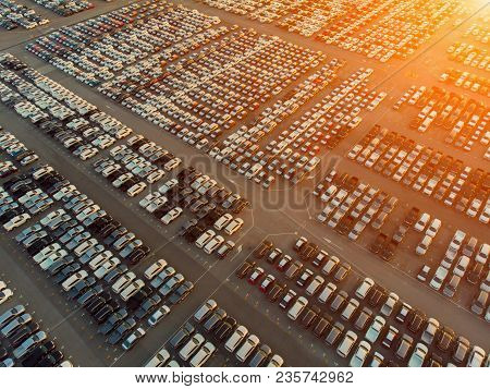 Aerial View A Lot Of Car For Import And Export Shipping By Ship.