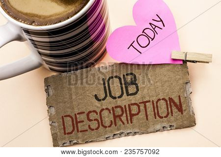 Text sign showing Job Description. Conceptual photo Document that establishes duties requirements exprerience written Tear Cardboard Piece the plain background Pink Heart and Coffee Cup. poster
