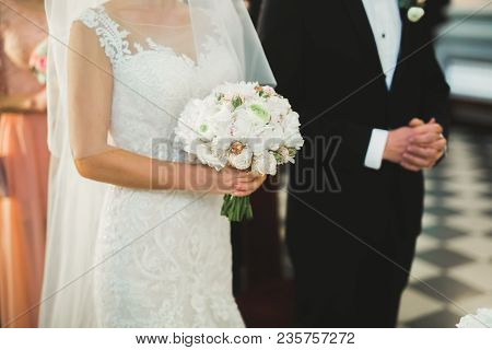 Wedding Couple Bide And Groom Get Married In A Church.
