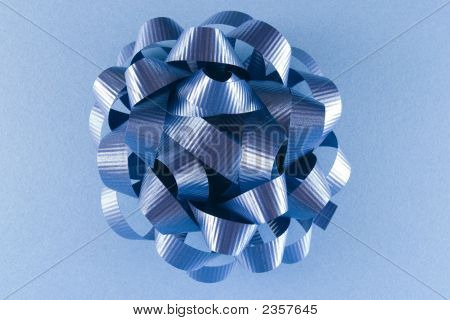 Blue Gift Bow On Blue Background