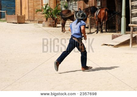 Cowboy Running Over The Street