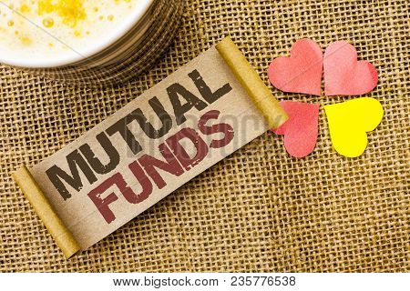 Writing note showing  Mutual Funds. Business photo showcasing Investment Strategy to purchase shares with other investors written sticky Note the jute background Love Hearts next to it. poster