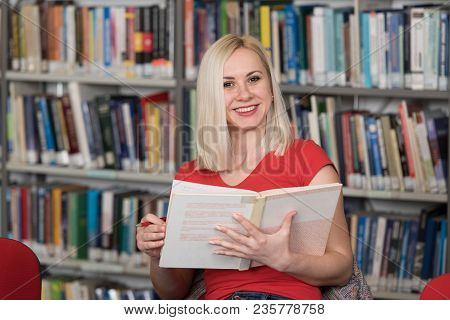 Happy Blonde Woman Working In The Library