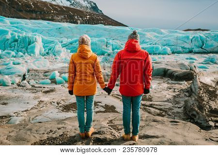 Traveling Man And Woman Exploring The Iceland Together. Ice Lagoon. Iceland Travelin. Rear View