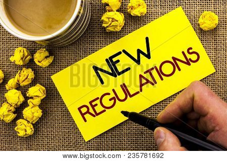 Text Sign Showing New Regulations. Conceptual Photo Change Of Laws Rules Corporate Standards Specifi