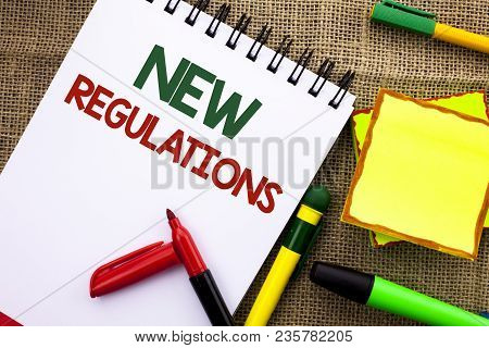 Writing Note Showing  New Regulations. Business Photo Showcasing Change Of Laws Rules Corporate Stan