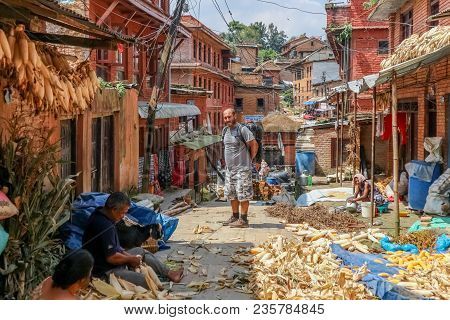 Kathmandu, Nepal - September 22, 2016: Tourist Watching Nepalese People Preparing Corns For Sale On
