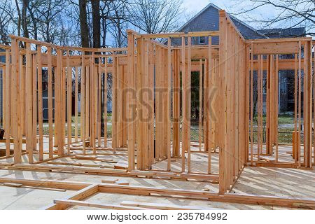 Framing Structure Wood Frame Of Wooden Houses Home. Closeup New Stick Built Home Under Construction