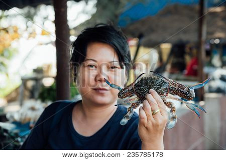 Asian Woman And Flower Crab At Thai Seafood Market