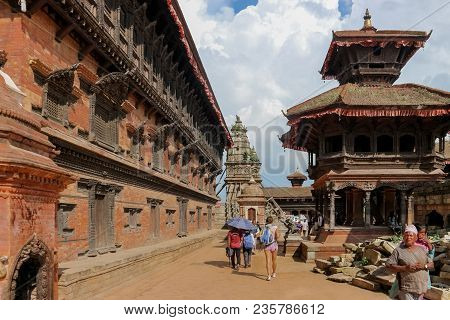 Kathmandu, Nepal - September 22, 2016: People Walking In Durbar Square On A Sunny Day In Bhaktapur,