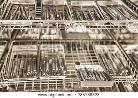 Many Sets Of Dental Instruments In The Sterilization Box