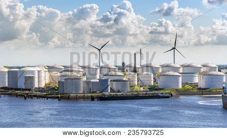 Large Port Terminal With Oil Storage Silo Tanks.