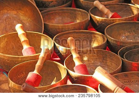 Singing Bowls Of Bronze. Golden Singing Bowls Are Sold On The Market In India. Tibetan Singing Thick